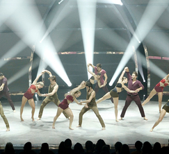 The Top 16 perform a group routine choreographed by Mandy Moore.