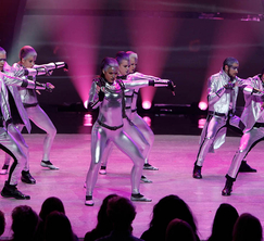 The Top 8 perform a group routine choreographed byTravis Payne.