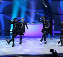 The Top 6 perform a routine choreographed by Nick DeMoura.