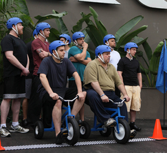 The chefs will work in pairs, riding tricycles to a cooking station where a culinary challenge awaits.
