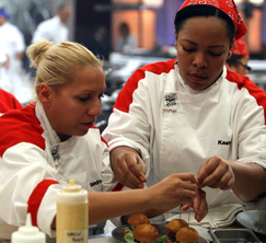 Sandra and Kashia work hard to get appetizers out faster than the Blue Team can.