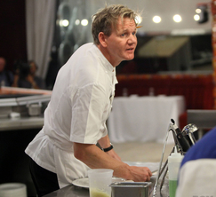 Chef Ramsay checks on Ralph who is making the bride and groom's entrees.