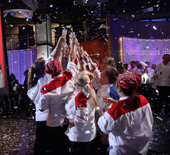 The two teams celebrate Scott's well deserved victory as the Season 12 winner of Hell's Kitchen.