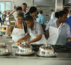 The 18 new chefs race through the kitchen to finish the challenge on time.