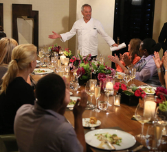 The women receive a warm welcome from Wolfgang Puck at their reward dinner.