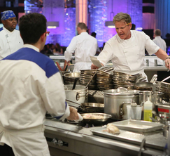 Chef Ramsay yells out orders to the Blue Team during dinner service in Hell's Kitchen.