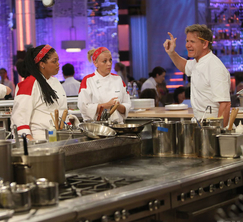Chef Ramsay kicks the Red Team out of the kitchen after delivering raw salmon.