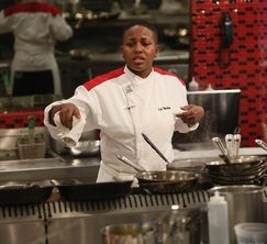 LaTasha makes sure her salmon dishes were just right.