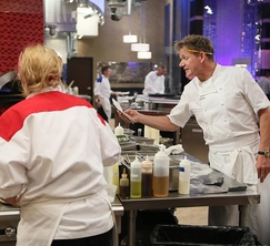 Gordon Ramsay gives the Red Team their dinner service orders.