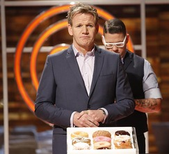 The judges reveal that the remaining cooks will have to create a box of 12 stunning doughnuts in 90 minutes.