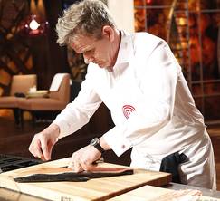 Chef Ramsay filets his salmon alongside the contestants.