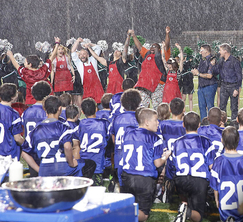The Red Team celebrates a victory in the pouring rain!