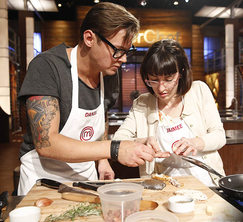 Daniel and Jaimee try to figure out how to prepare the chicken wings they received.